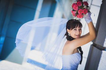 bride against a blue modern building background