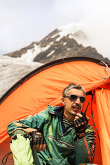 The rescuer in mountains talks on handheld transceiver