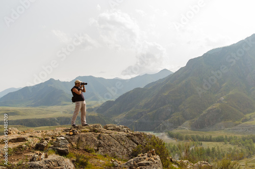 Beautiful landscape with the silhouette of photographer on backg