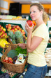 woman buys vegetables and fruits