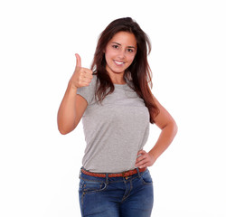 Charming young woman gesturing positive sign