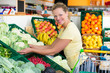 woman buys organic food