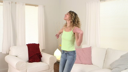 blonde woman with curly hair dancing