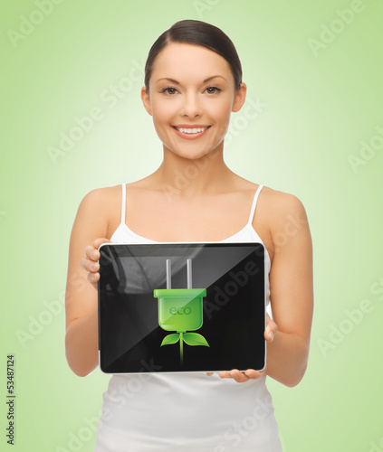 woman holding tablet pc with green electrical plug