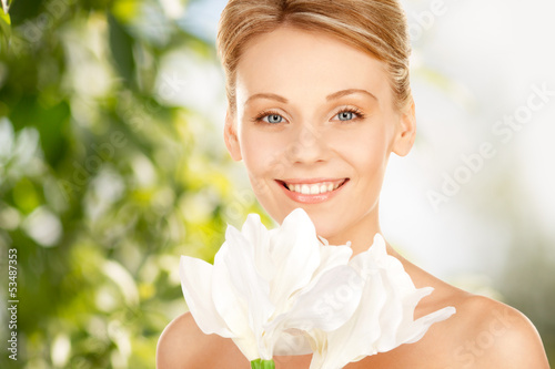 lovely woman with lily flower