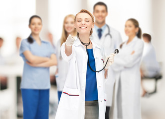 attractive female doctor pointing her finger
