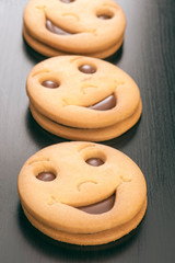 group of smiling filled chocolate biscuits