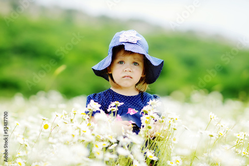 serious girl in field
