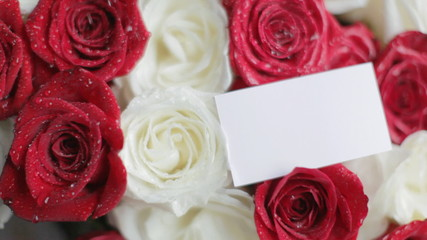 Business card on roses