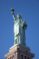 Statue of Liberty complete blue sky background