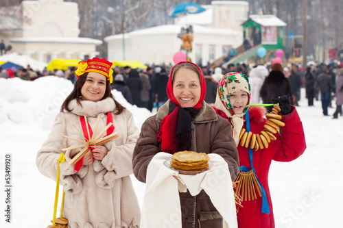women  with pancakes and round cracknel