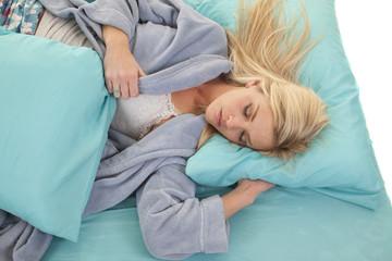 woman sleep blue pillows