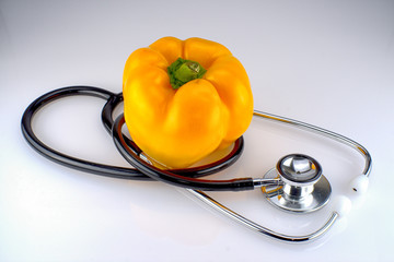 A stethoscope with a yellow pepper