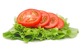 tomato vegetable and lettuce salad isolated on white background