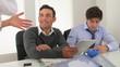 Multi-ethnic businessmen listening to direction from female mana