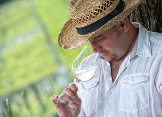 Winemaker drinks white wine