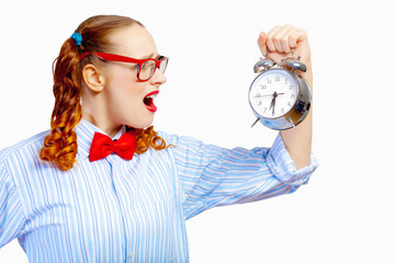 Teenager girl holding alarm clock