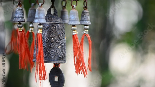 Feng Shui Chinese Bell and Coin being blown