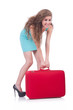 Woman with suitcase before travel