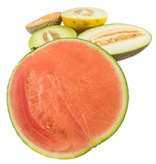 Various type of melons cut in half over white background