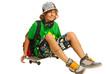 Happy teen sitting on skateboard