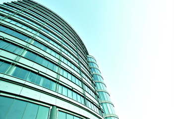 wide angle view to steel blue background of glass high building