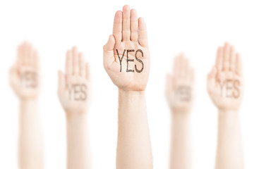Hands raised to the sky and saying Yes.