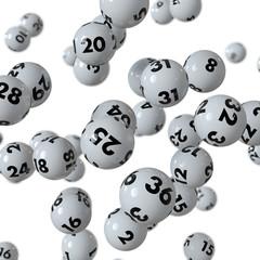 Lottokugeln rollen auf weißem Hintergrund