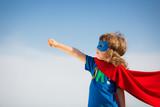 Fototapety Superhero kid. Girl power concept