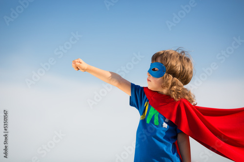 Leinwandbild Motiv Superhero kid. Girl power concept