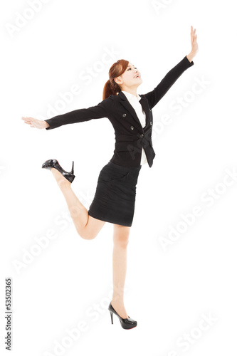 happy businesswoman jumping and try to reach something