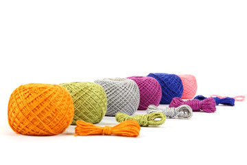 Colored skeins of thread isolated on a white background.