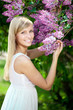 Smiling beautiful woman with violet flowers