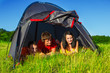 Hikers lying in the tent