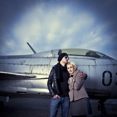Couple in front of fighterplane