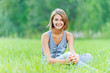 young woman sitting grass