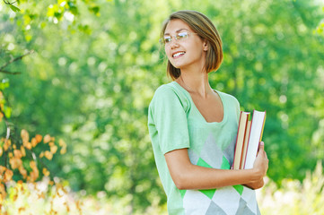 smiling beautiful young woman-student with books