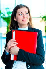 Encouraged by a businesswoman holding a red folder