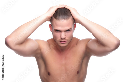 topless fashion man with hands on head