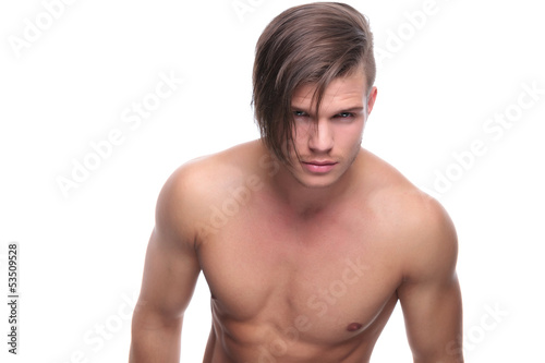 topless fashion man looks into your eyes