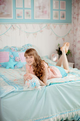 Cute young girl in the children's bedroom