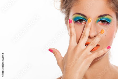 Beautiful caucasian woman with artistic makeup