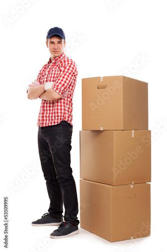 Handsome young courier with brown boxes