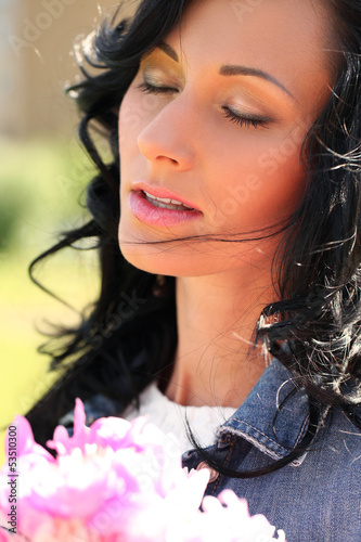 Beautiful woman in the park with bouquet