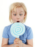 Girl is suprised about the size of the lollypop