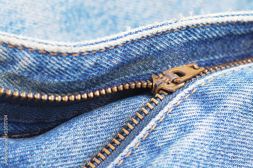 close-up of the zipper of blue jeans