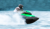 Men on a high speed jet ski