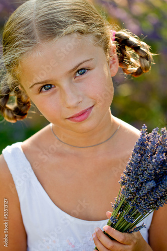 Portrait of lovely girl with bunch of lavender flowers
