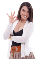 Business woman with an ok sign - isolated over a white backgroun