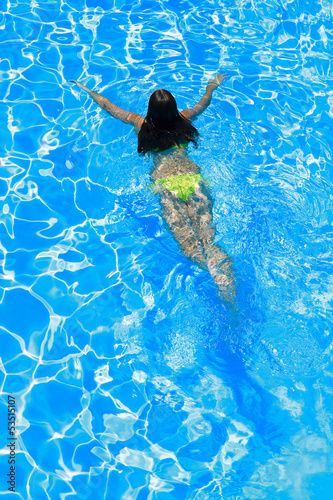 woman swimming in the swimming pool